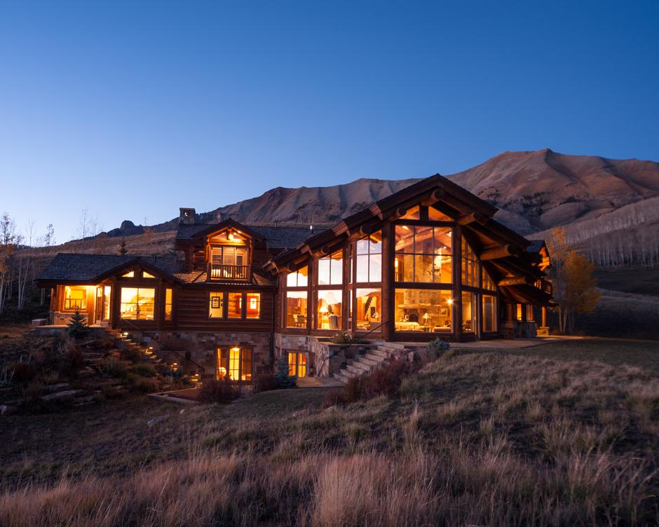 2SS Log and Stone Mountain Home Exterior Wide View at Dusk - Contemporary Mountain Log Home in Near Telluride, CO